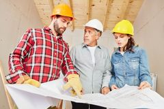 Artisans and craftsman planning in teamwork. For renovation of building stock photography
