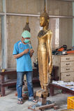 Artisans renew damaged by war buddha statues in the workroom Royalty Free Stock Photos
