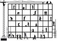 Artisans sur le chantier de construction Photo libre de droits
