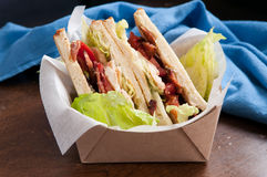 Artisinal clubhouse sandwich for take out Stock Photography