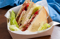 Artisinal clubhouse sandwich for take out. Food truck take out club sandwich, clubhouse style Royalty Free Stock Photos