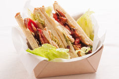 Artisinal clubhouse sandwich for take out. Food truck take out club sandwich, clubhouse style Royalty Free Stock Photography