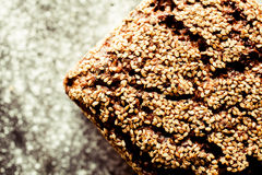 Artisinal Whole Grain Bread Topped by Sesame Seeds Royalty Free Stock Image