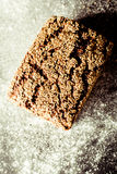 Artisinal Whole Grain Bread Topped by Sesame Seeds Stock Photo