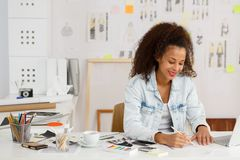 Artisitic female during work. Image of artistic female during work at studio Stock Image