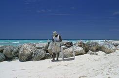 Artist. An artist on the beach royalty free stock photo