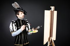 Artist. Portrait of a handsome man artist in 16th century costume. Shot in a studio Royalty Free Stock Image