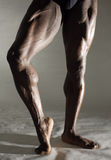 Artist. Muscular Black Male dancers legs Royalty Free Stock Images