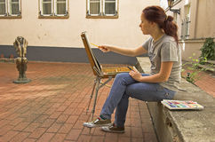 Artist. The young artist in the street of Riga Stock Photography
