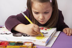 Artist. Child concentrated on drawing a picture stock images