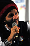 Artist Alborosie from Jamaica answers the questions at the press conference Royalty Free Stock Images