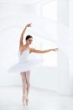 Artist. Beautiful ballerina dancing in studio stock photography