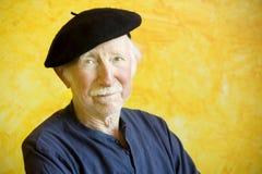 Artist with a Beret. Portrait of an elderly painter wearing a beret Stock Photo