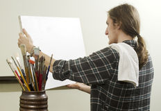 Artist with blank canvas. Artist with brushes and blank canvas stock photo