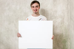 Artist with blank picture Stock Photo