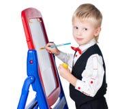 Artist boy painting isolated on white background Stock Photo