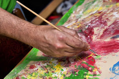 Artist with brush Stock Images