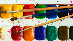 Artist brush and paint Royalty Free Stock Photos