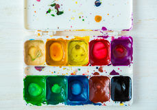 Artist brush and paint Stock Image