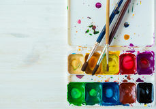 Artist brush and paint Stock Photography