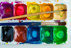 Artist brush and paint. Background Royalty Free Stock Photography