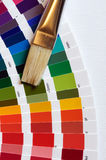 Artist brush with paint color chart on canvas Royalty Free Stock Images