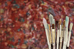 Artist brushes. A collection of artist brushes against an original abstract background Stock Photo