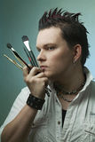 Artist with brushes Stock Images