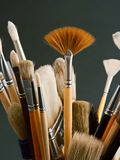 Artist brushes. In a pot, on a dark grey background Royalty Free Stock Photography