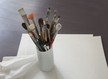Artist brushes with blank canvas Stock Photography
