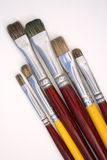 Artist brushes on canvas Stock Images
