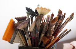 Artist brushes close up. Used artist brushes in different sizes in a box Royalty Free Stock Photos