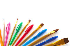 Artist brushes and coloured pens Royalty Free Stock Images