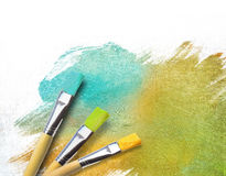 Artist brushes with a half finished canvas Stock Images