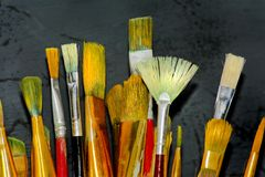 Artist brushes. Painting brushes on dark background Stock Photography