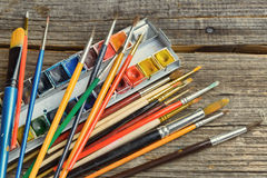 Artist brushes and paints Stock Images