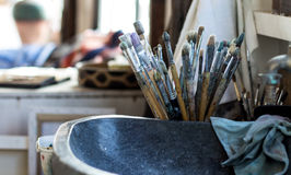 Artist brushes and paints. On an painter studio Royalty Free Stock Photos