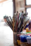 Artist brushes and paints. On an painter studio Stock Photo