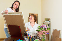 Artist and buyer in the art studio Royalty Free Stock Images