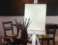 Artist canvas with brushes. View past brushes of blank artist canvas royalty free stock photos