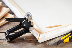 Artist canvas, canvas stretcher and staple gun Stock Photography