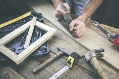 Man working in wood royalty free stock images