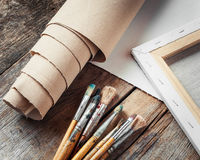 Artist canvas in roll, canvas stretcher and paintbrushes royalty free stock image