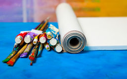 Artist canvas in roll, canvas stretcher and paintbrushes . Stock Photo