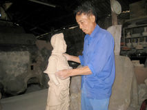 Artist  of Cay pottery village  clay statue of a deity Royalty Free Stock Photo
