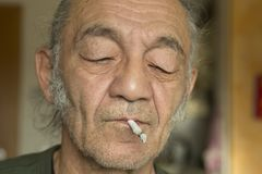 An artist with cigaret in his mouth Stock Image
