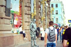 Artist in the costume of a knight on Nevsky Prospect in St. Petersburg royalty free stock photos