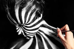 Artist create body art on the girl's body. Look like zebra pattern skin Stock Photos