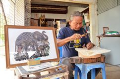 Artist creates the hand craft by using buffalo skin in Ayutthaya Stock Photography