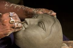 Artist creates the head of a goddess. An Artist creates the head of a goddess festival in Kumartuli, Calcutta, India royalty free stock images